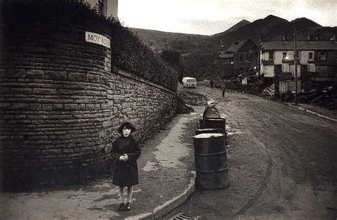 A young girl stands at the end of Moy Road, Aberfan, where